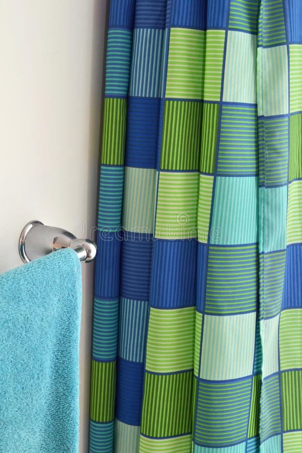 Shower curtain and towel rack. Bathroom scene with shower curtain and towel rack royalty free stock photography