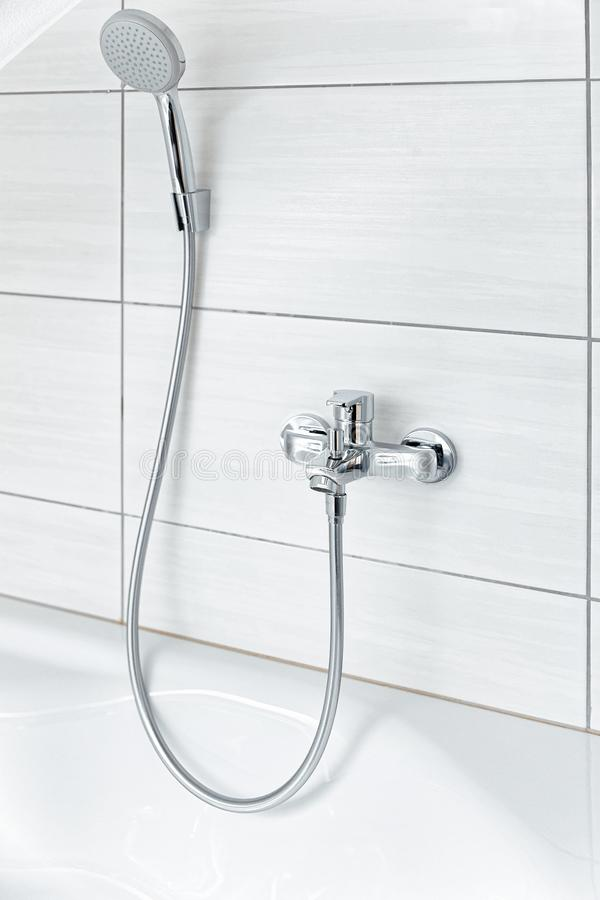 Shower head and metal tap Modern in white Bathroom stock photos