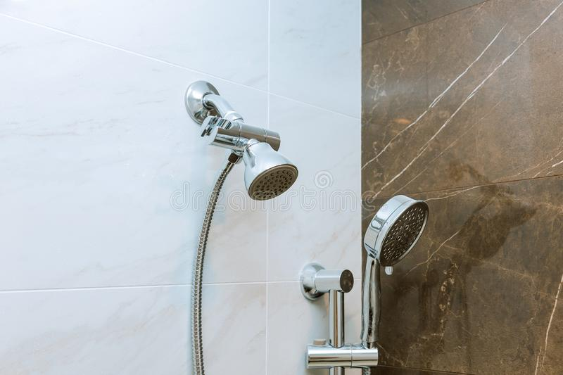 Modern shower head in bathroom with new home construction stock photo