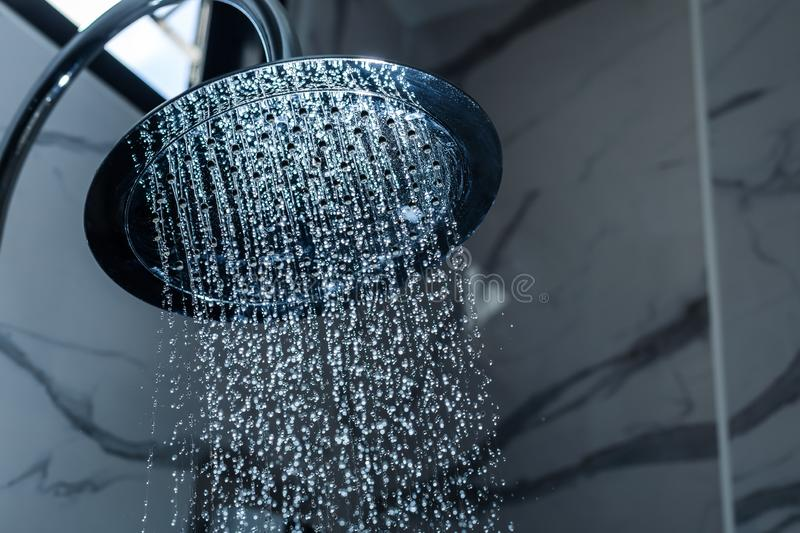 [shower head] shower head in bathroom with water drops flowing royalty free stock photos
