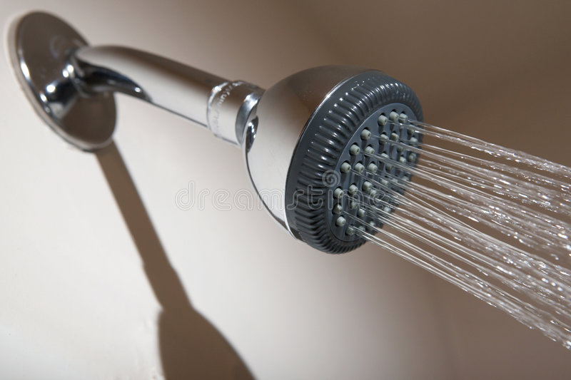 Shower head spraying water stock images