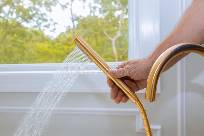 Shower head with stream water in domestic bathroom stock image