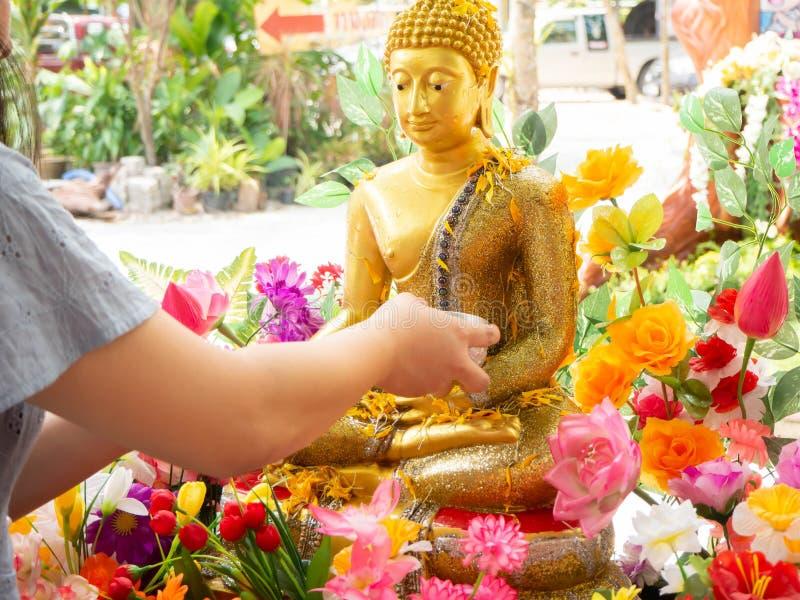 Shower the monk sculpture,Songkran festival,Natakwan Temple,rayong,thialand. Shower the monk sculpture Songkran festival Natakwan Temple rayong thialand stock photos