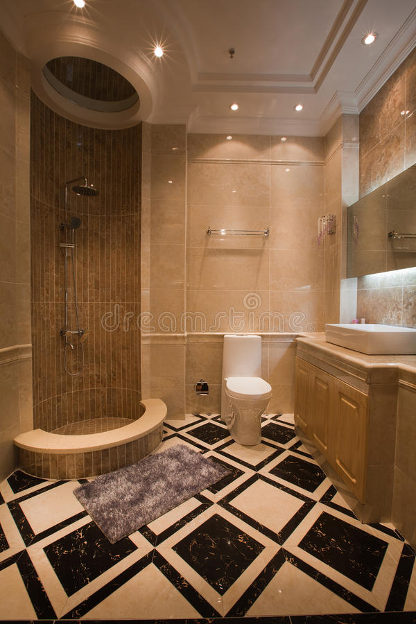The shower room. The changing of family decoration to the hotel style, shown in the picture is a shower room of Chinese villa royalty free stock image