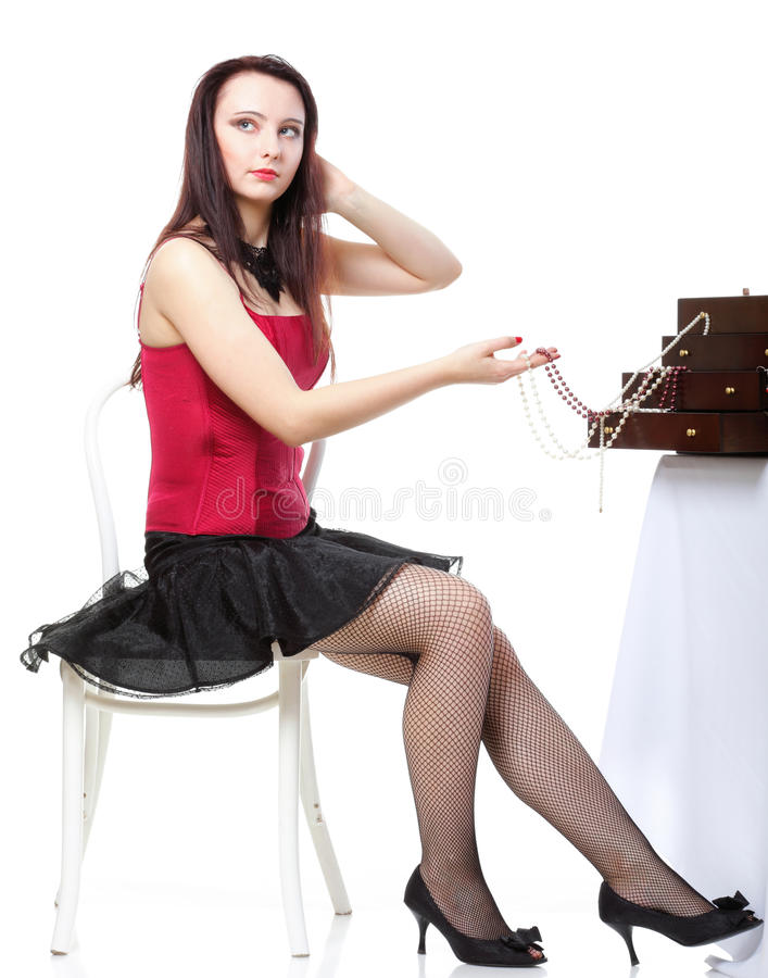 Download Showgirl  In Red Corset And Beads Isolated Stock Photo - Image: 23619134