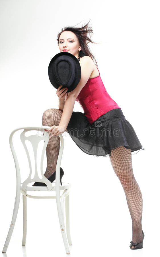 Download Showgirl Woman Dance In Red Corset Chair White Isolated Stock Image - Image: 28928847