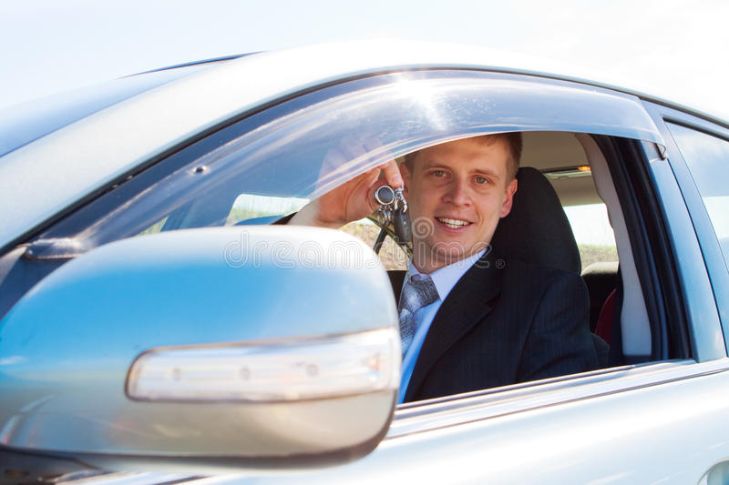 Showing car keys. Smiley businessman showing his new car keys royalty free stock images