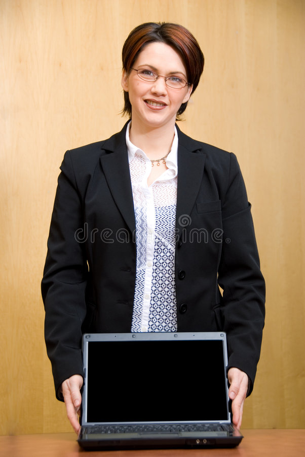 Showing her laptop. Business woman holding her laptop to show people royalty free stock photos