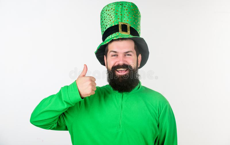 Showing his thumbs up. Happy irish man with beard wearing green. Hipster in leprechaun hat and costume. Bearded man. Celebrating saint patricks day. Happy saint stock image