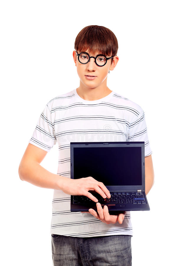 Showing laptop. Portrait of a smart young man with a laptop. Isolated over white background royalty free stock photography