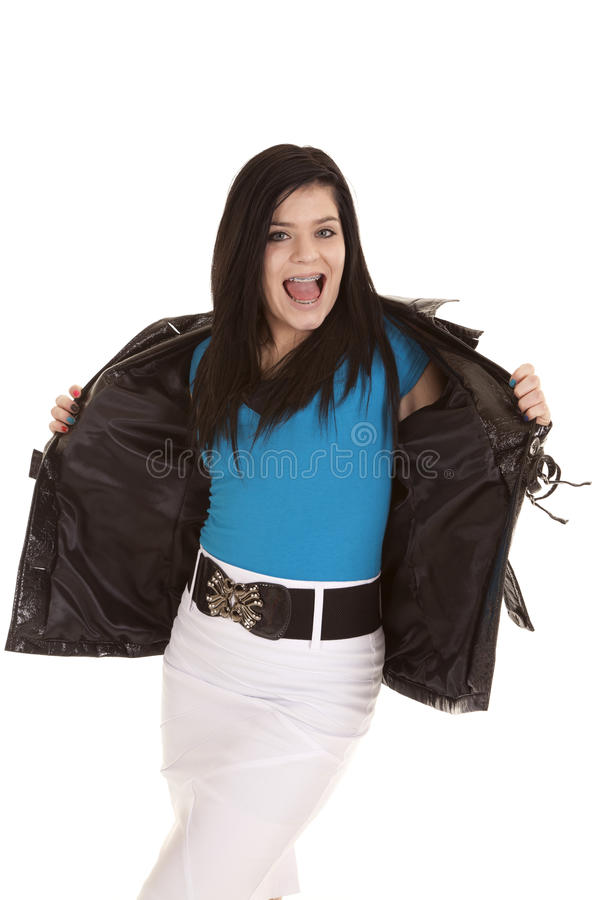 Showing off jacket teen black. A teen girl showing off her awesome jacket with a smile on her face stock photography
