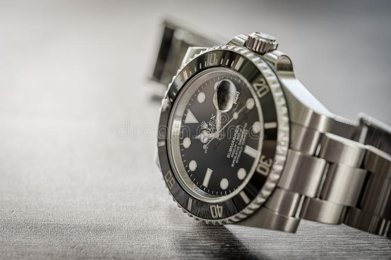 Rolex Submariner. Closeup, shallow focus of an iconic, swiss-made men`s mechanical divers watch. stock photos