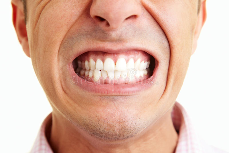 Showing the teeth royalty free stock photography