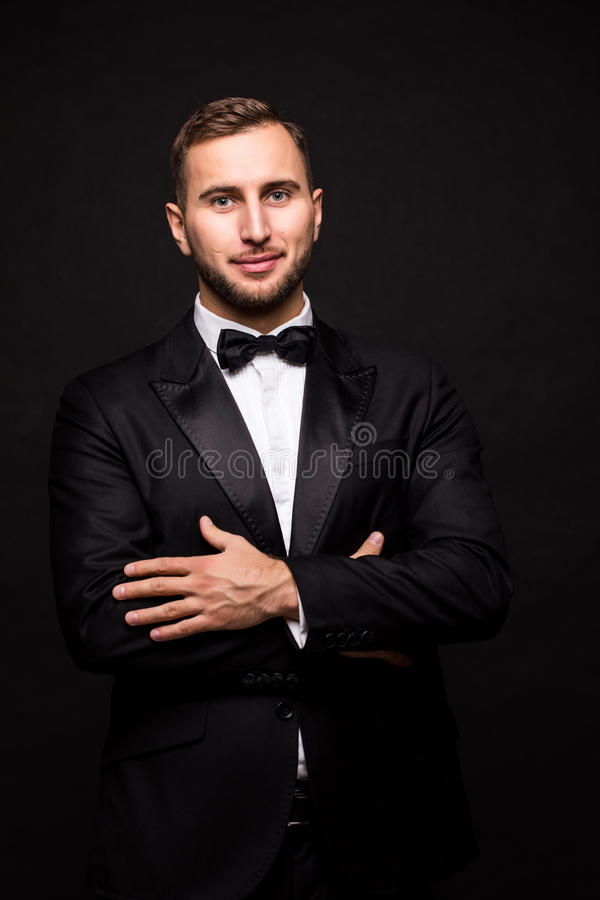 The showman in suit over black background. stock photo