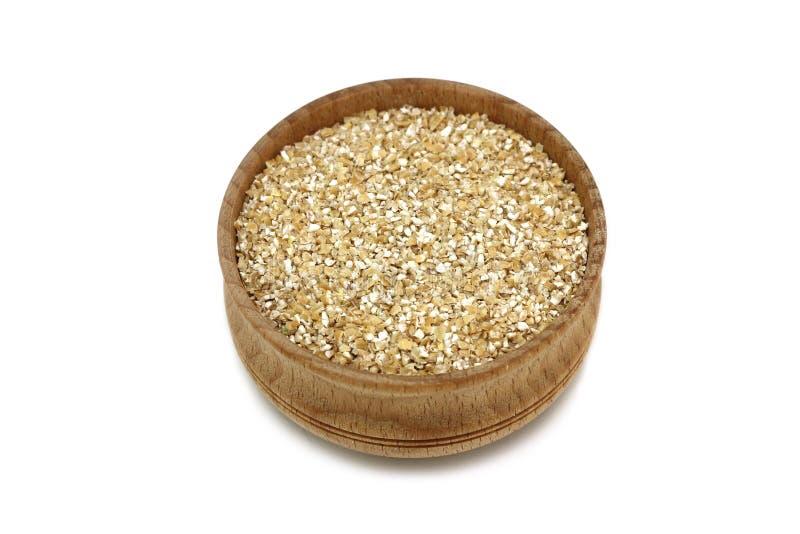 Shredded пшеница в деревянные утвари стоковое фото rf