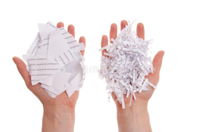 Shredded paper in hand stock image