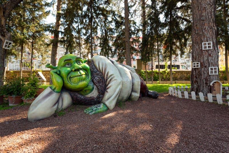 Shrek life-size figure lying in amusement miniature park, Antalya, Turkey. Life size statue of Shrek lying in the amusement miniature park Minicity in Antalya stock photography