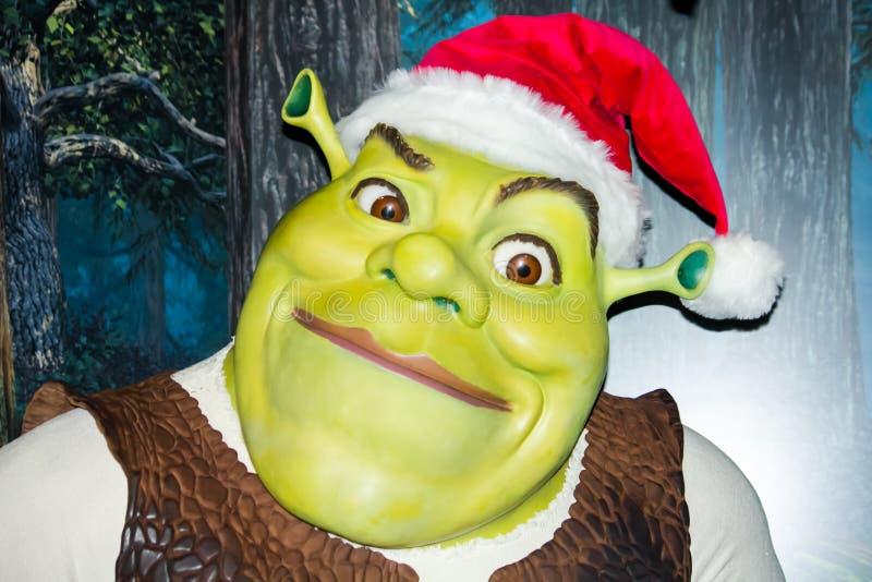 Shrek som förbereder sig för jul royaltyfri illustrationer
