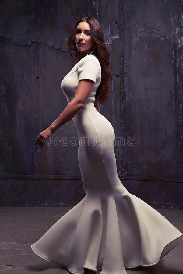 A shrewd look of pretty model walking and looking at the camera royalty free stock image