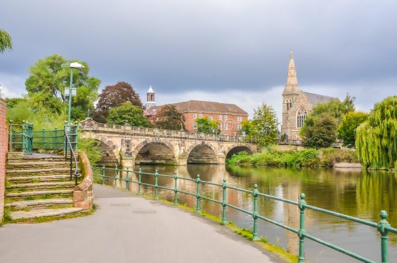Shrewsbury town river scene with bridge and church stock photos