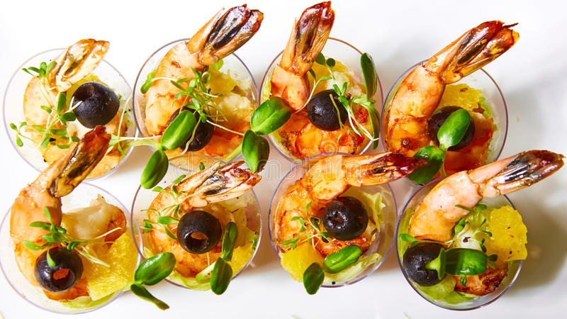 Shrimp, avocado, tomato, salmon cocktail salad served in a glass. stock image