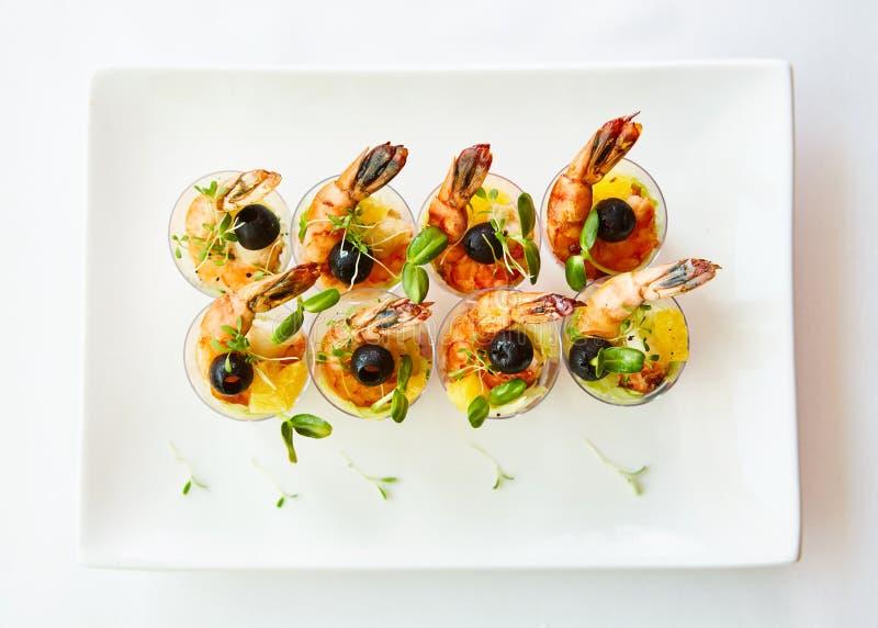 Shrimp, avocado, tomato, salmon cocktail salad served in a glass. royalty free stock photos