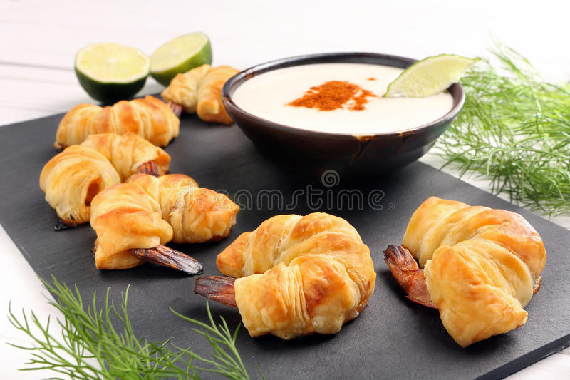 Shrimp baked in puff pastry with dip royalty free stock photo