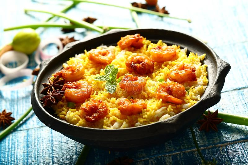 Shrimp biryani,famous Indian cuisine. Homemade delicious sea food biryani with prawns,shrimps, exotic spices and herbs royalty free stock images