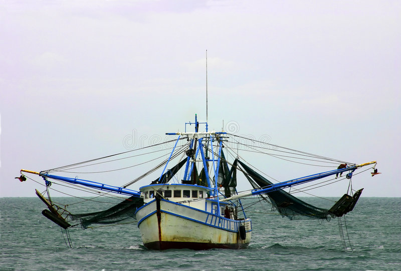 Shrimp boat with nets stock images