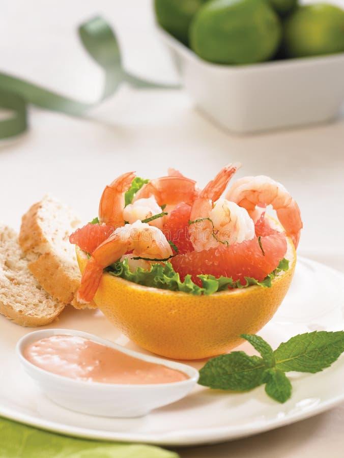 Shrimp cocktail with grapefruit and sweet chili sauce stock photos