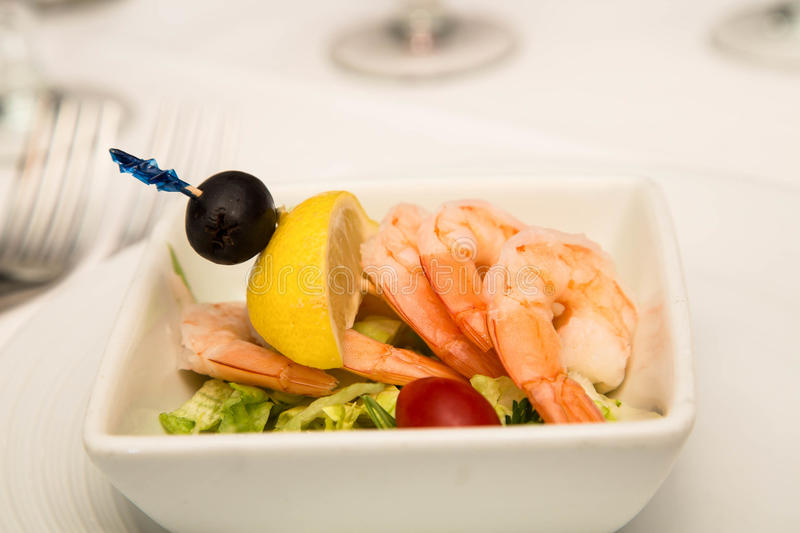 Shrimp Cocktail with Lemon Wedge and Olive royalty free stock photos
