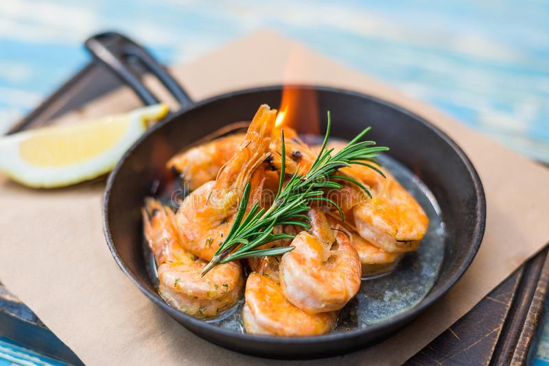 Shrimp with fire in a frying pan stock images