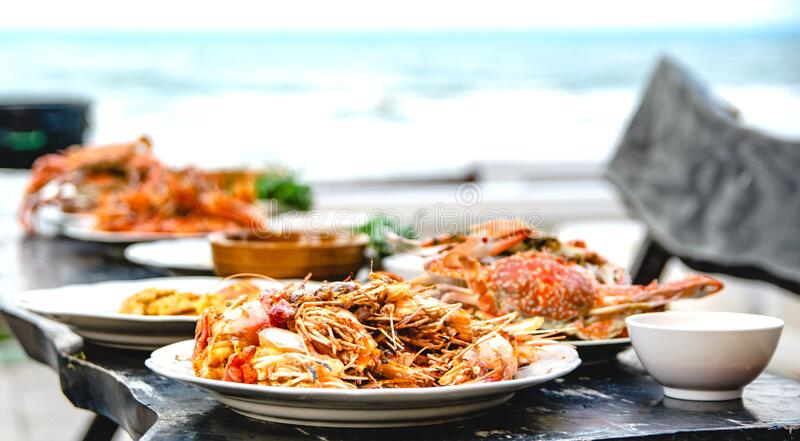 Shrimp fried garlic seafood of restaurant with other dishes in the background stock photography