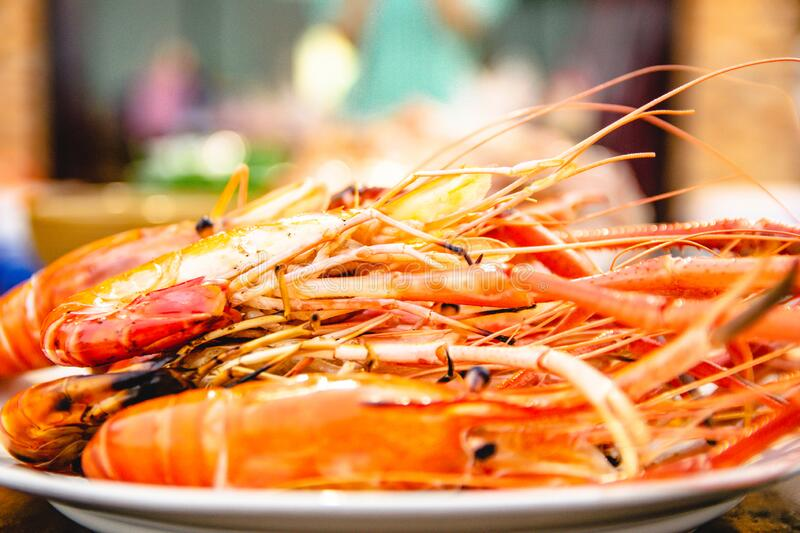 Shrimp grill seafood of restaurant with other dishes in the background royalty free stock photo