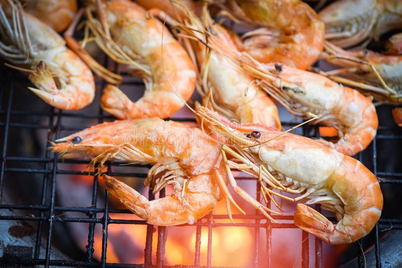 Shrimp grilled bbq seafood on stove / prawns shrimps cooked burnt on grill barbecue royalty free stock photos
