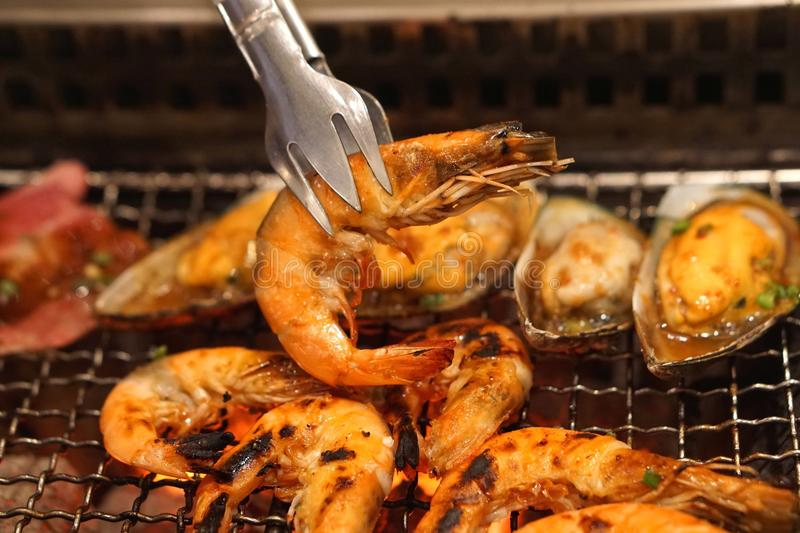 Shrimp grilled bbq seafood on stove - soft and select focus with warm tone color stock photography