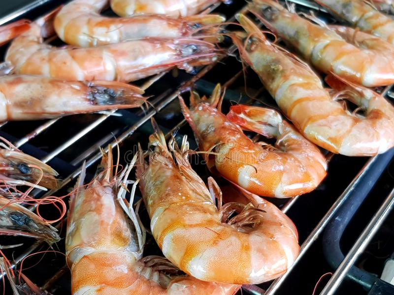 Shrimp has been cooked on barbeque grill background stock images