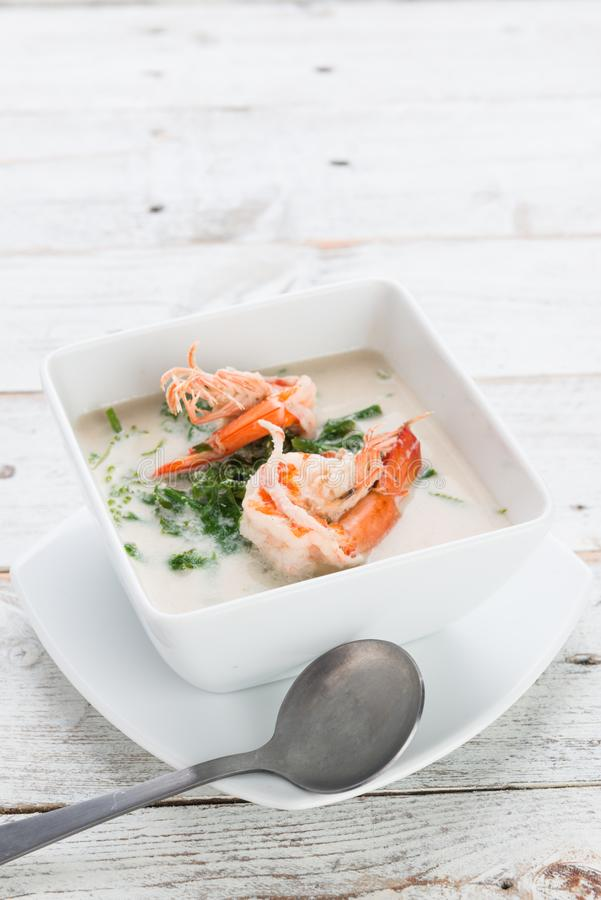 Shrimp and Paco fern (Diplazium esculentum) boil with coconut mi. Lk soup phuket thai style healthy food stock photos