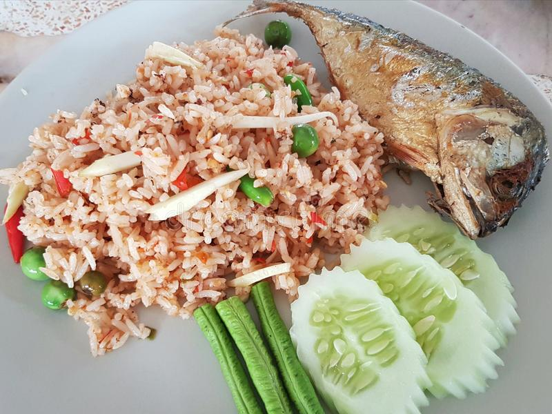 Shrimp-paste fried rice with Fried mackarel. Sauce, thai, food, mackerel, cuisine, set, delicious, vegetable, spicy, white, healthy, fresh, lunch, thailand stock image