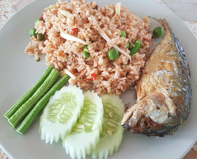 Shrimp-paste fried rice with Fried mackarel. Sauce, thai, food, mackerel, cuisine, set, delicious, vegetable, spicy, white, healthy, fresh, lunch, thailand royalty free stock image