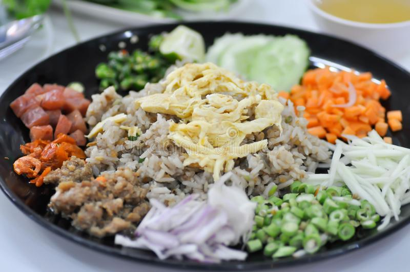 Shrimp paste rice, fried rice or stir-fried rice with egg and vegetable stock photo