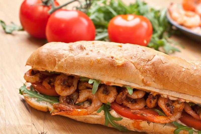 Shrimp Po-Boy Sandwich. With Tomato and Rocket stock photos