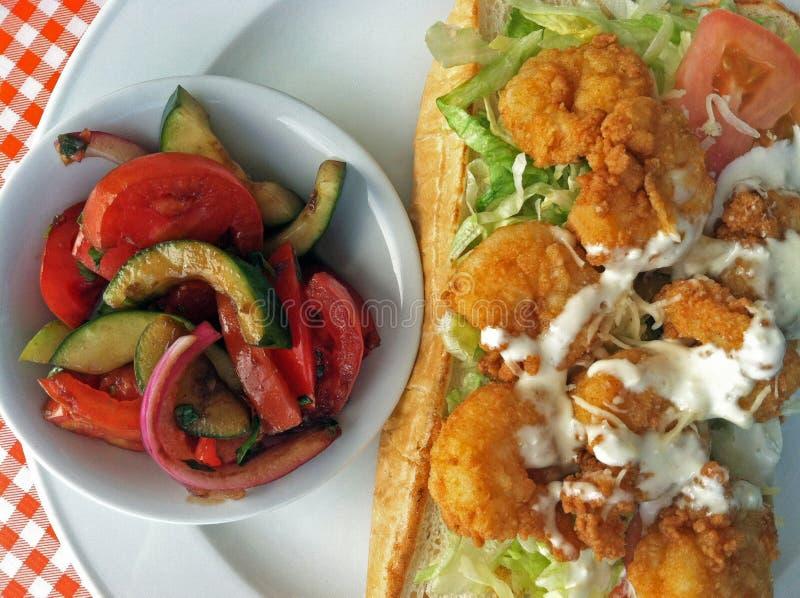 Shrimp PoBoy with grilled vegetable side. On a hoagie roll, shrimp po`boy comes alongside grilled vegetables royalty free stock image