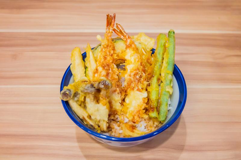 Shrimp or Prawn and Vegetables tempura with deep fried on cup put on the wooden table. Japanese food stock photos