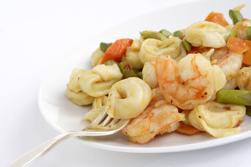 Shrimp and ravioli stock image