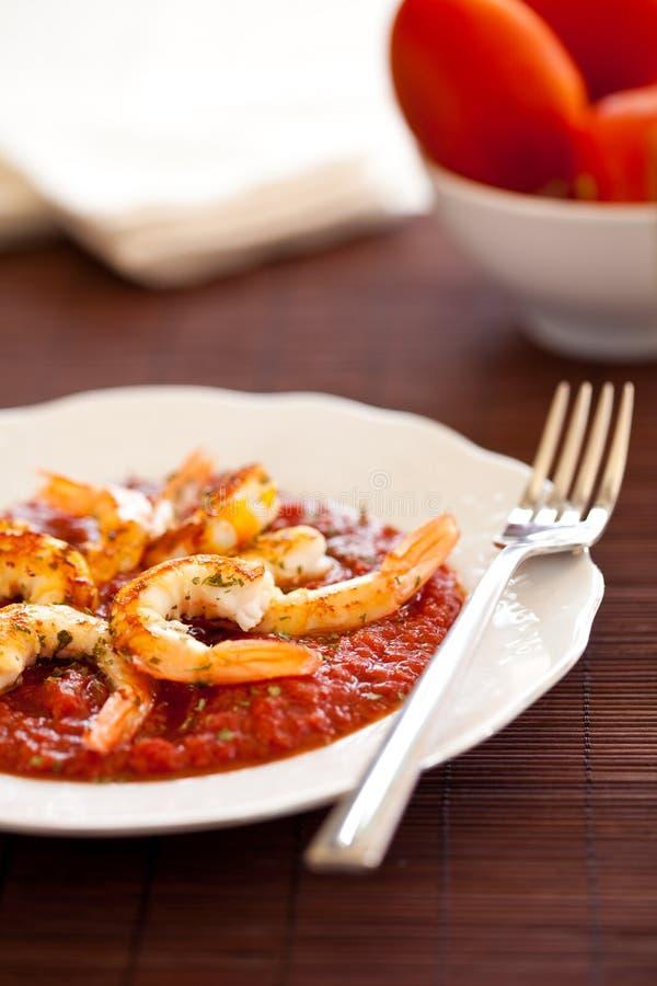 Shrimp roasted with fried tomato royalty free stock photography