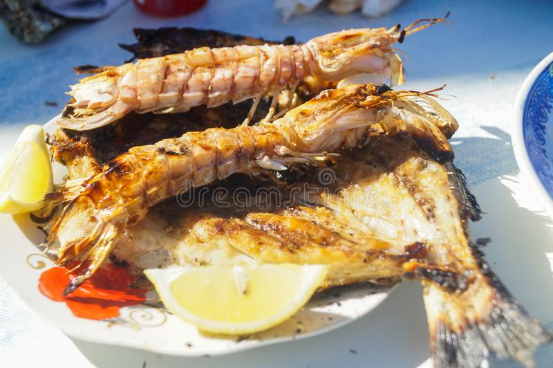 Shrimp royal, grilled. Appetizing steaming prawns on a hot brazier stock images