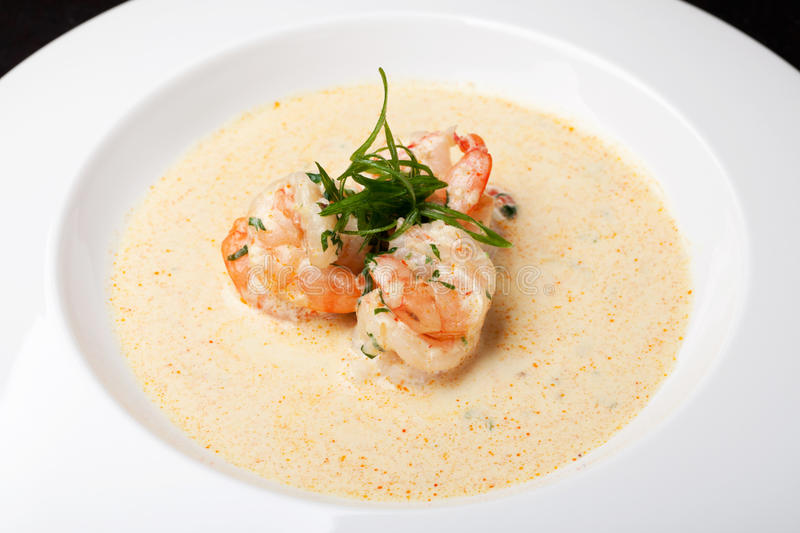 Shrimp in sauce. On a white plate stock photos