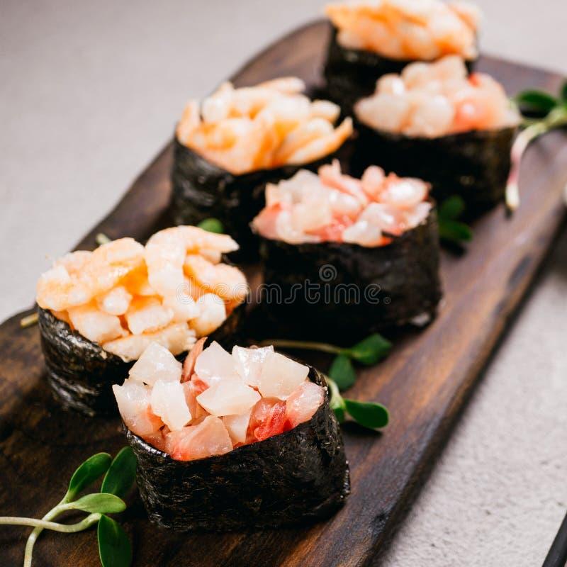 Shrimp and sea bass gunkan maki sushi rolls set royalty free stock photos