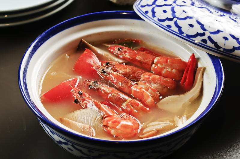 Shrimp soup with mushroom in Chinese style on bowl stock image